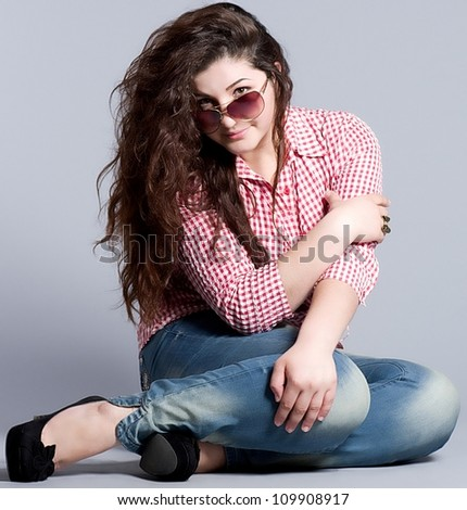 Young fashionable woman in jeans - stock photo