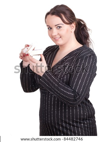 young fat woman in dark dress with gift box - stock photo