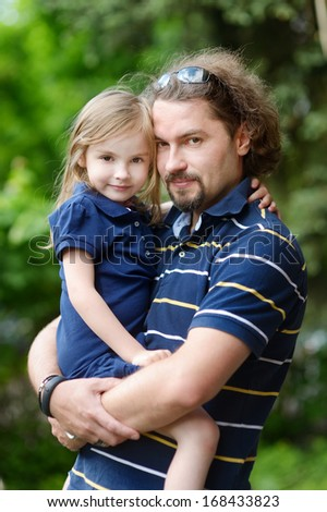 Young father and his adorable daughter - stock photo