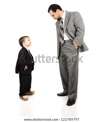 Young father and his son wearing suits - stock photo