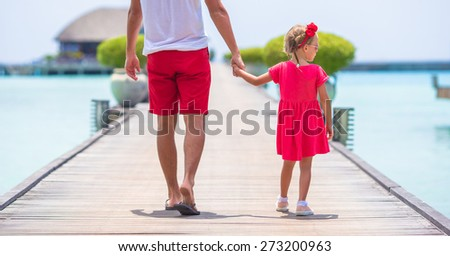 Young father and little girl during tropical vacation - stock photo