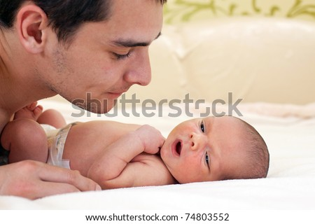 Young father and newborn baby boy - stock photo