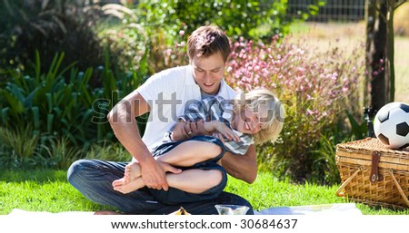 Young father and small son enjoying a picnic - stock photo