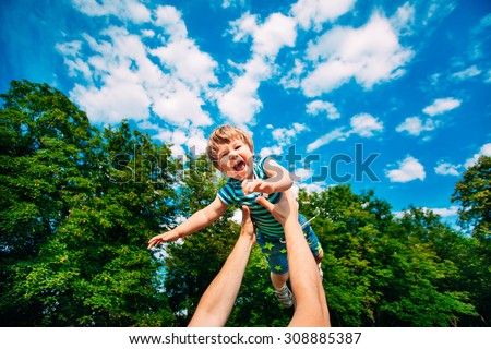 Young father and son playing in the park. - stock photo