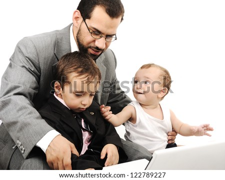 Young father and two kids with laptop - stock photo