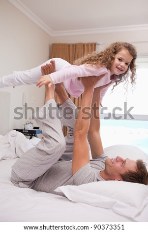 Young father letting his daughter fly - stock photo