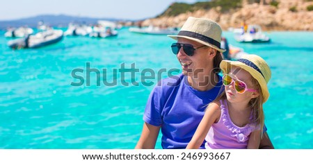 Young father with adorable girl resting on a big boat - stock photo