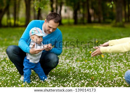 Young father with his awesome small kid - stock photo