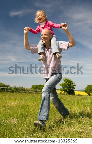 Young father with his daughter running fast - stock photo