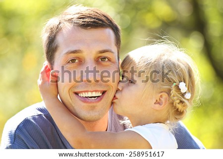 young father with his little daughter on nature - stock photo