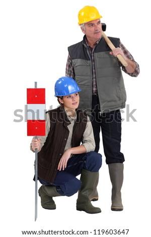 young female apprentice and senior carpenter - stock photo