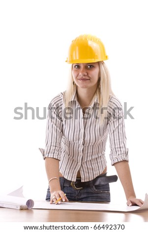 Young female architect with plans at the office - stock photo