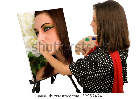 Young female artist painting her self portrait - stock photo