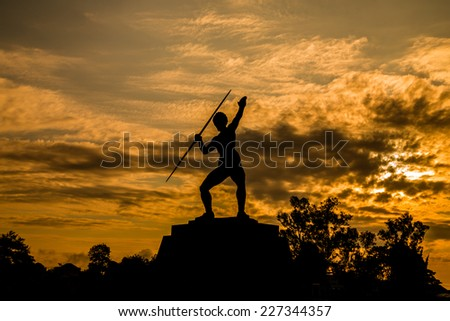 Young female athlete throwing javelin statue in Thailand - stock photo