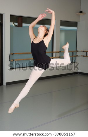 Young female ballerina jumping in the air - stock photo