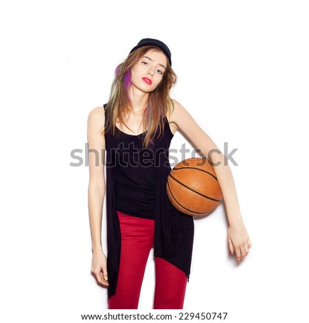 Young female basketball player holding ball, in white background, not isolated - stock photo