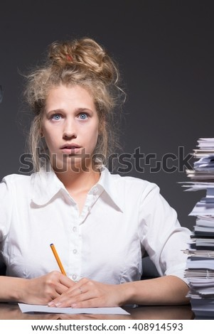 Young female bookkeeper being bullied at work - stock photo