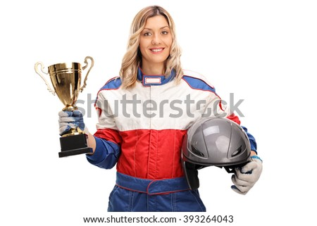 Young female car racing champion holding a gold trophy and looking at the camera isolated on white background - stock photo
