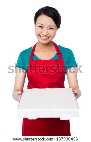 Young female chef delivering pizza, isolated on white background. - stock photo