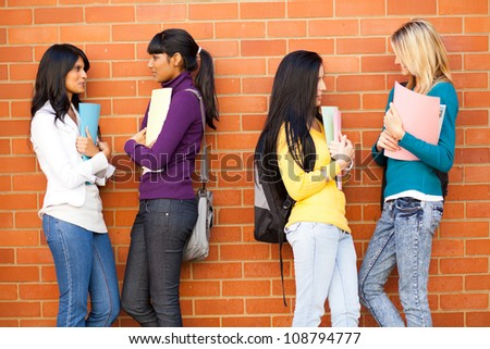 young female college friends chatting - stock photo