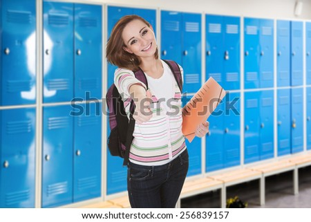 Young Female College Student In Changing Room Gesturing Thumb-up - stock photo