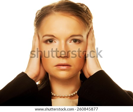 Young female covering her ears. Business concept. - stock photo