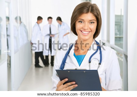 Young female doctor and her colleagues - stock photo
