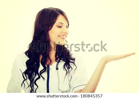 Young female doctor or nurse - stock photo