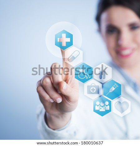 Young female doctor using a touch screen interface. - stock photo