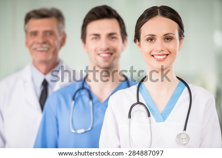 Young female doctor with colleagues at doctor's office. - stock photo