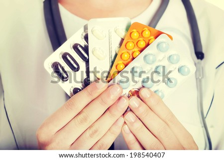 Young female doctor with pills - stock photo