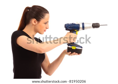 Young female dressed in black top holding a cordless electric drill on a white isolated background - stock photo