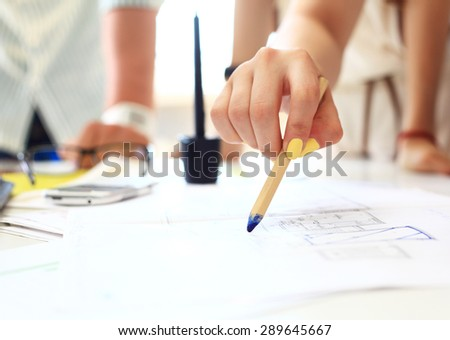Young female engineer working in office - stock photo