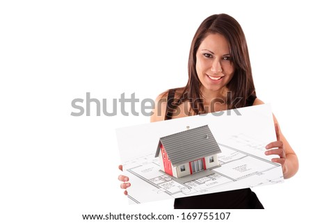 Young female estate agent promotes family house - stock photo