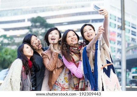 Young female friend taking selfie in Hong Kong - stock photo