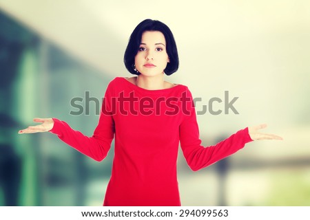 Young female gesturing do not know sign. - stock photo