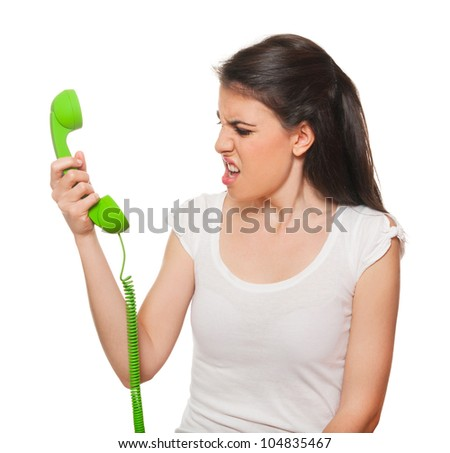 Young female getting stressed by someone on the phone. Isolated on white. - stock photo