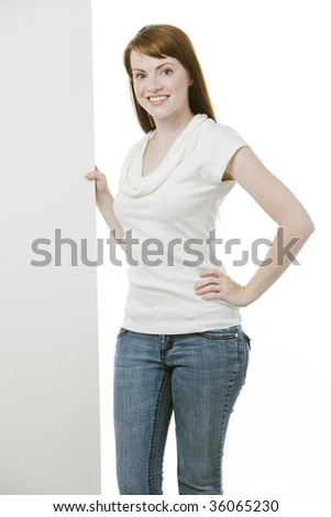 Young female holding a blank board over white - stock photo