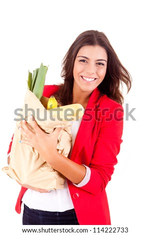 Young female holding a shopping bag on white background - stock photo