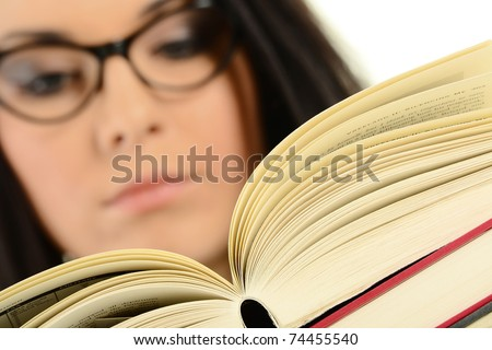 Young female holding an open book. Woman reading. - stock photo