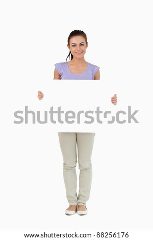 Young female holding sign against a white background - stock photo