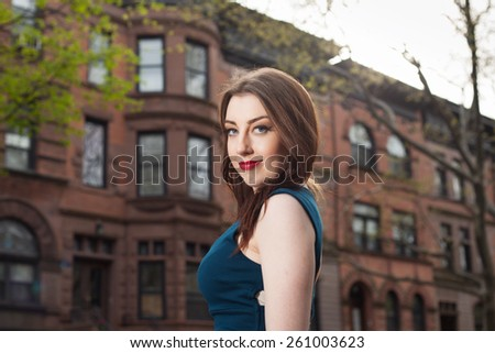 young female in brooklyn smiling - stock photo