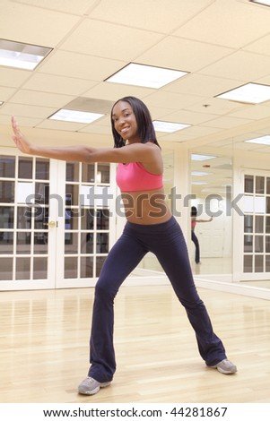 Young female in dancing pose - stock photo
