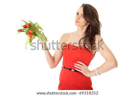 young female in red dress with bunch of red tulip flowers, isolated on white - stock photo