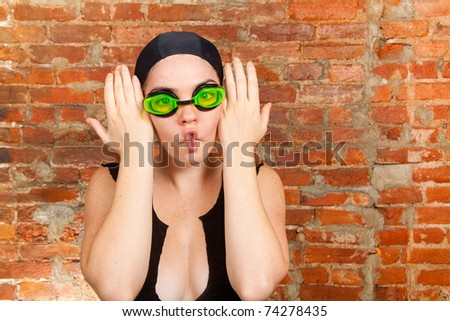 Young female in swimsuit making funny faces - stock photo