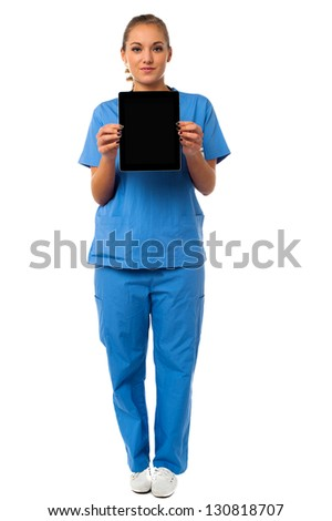 Young female medical specialist displaying a tablet device. - stock photo