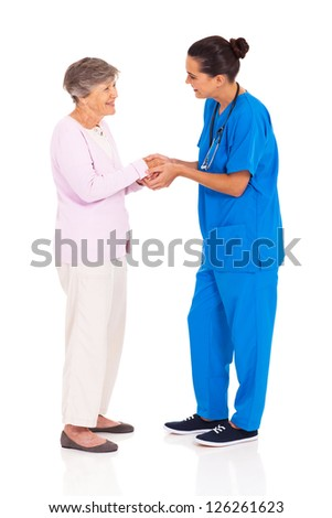 young female medical worker greeting senior woman isolated on white - stock photo
