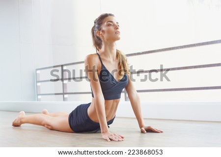 Young female model in sunlight studio with practic youga and relax - stock photo