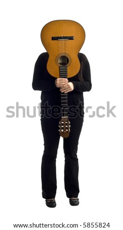 young female musician holding an acoustic guitar - stock photo