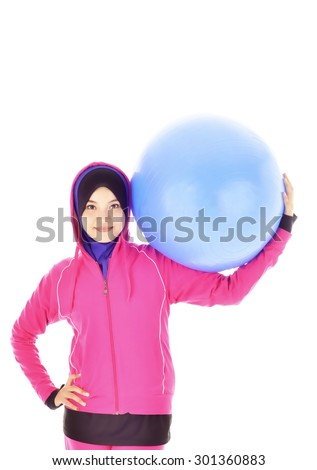 Young Female muslim doing exercise with white background  - stock photo